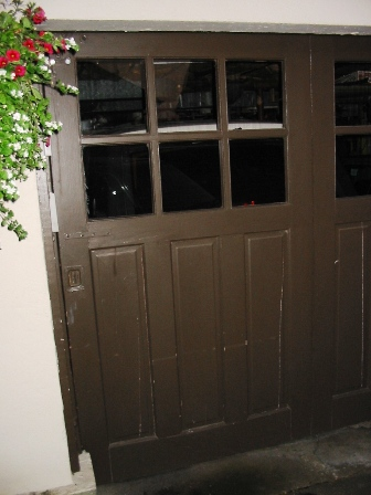 Custom Garage Doors or REAL Carriage Doors will solve this ugly situation for your carriage house garage doors.  Other opening styles for Custom Garage Doors or Carriage Doors include:  Out-Swing, In Swing, Hinged, Swinging, Slide, or Fold.  The  choice is yours for a carriage house door, custom garage doors, or real carriage doors!