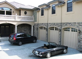 An Italian villa on the waterfront as part of the swing carriage doors porfolio of showcase clients.  This Seattle garage door has custom arches to match!