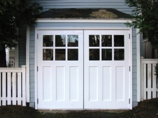 Seattle Garage Doors for your garage door built and installed to open as Swing-out Carriage Doors.  Other opening styles for these Hinged Carriage Doors include:  Swing-out, Slide, or Fold.  The choice is yours for a real carriage house door for your Seattle garage door!
