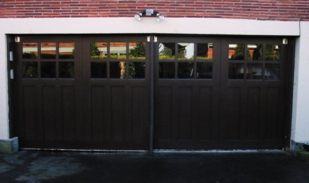 Custom Carriage Garage Doors for your beautiful home. Built and installed to roll up in sections as traditional garage doors.  Other opening styles for these Custom Carriage Style Garage Doors include:  Swing-out, In Swing, Hinged, Swinging, Slide, or Fold.  The choice is yours for a custom carriage house  garage door!