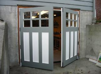 swing carriage doors for your carriage house garage!  Also, known as swing carriage doors, hinged carriage doors, swinging carriage doors, or swing-out carriage doors.  These carriage house doors are custom hand-crafted one at a time by a TRUE real carriage house door company - www.vintagegaragedoor.com