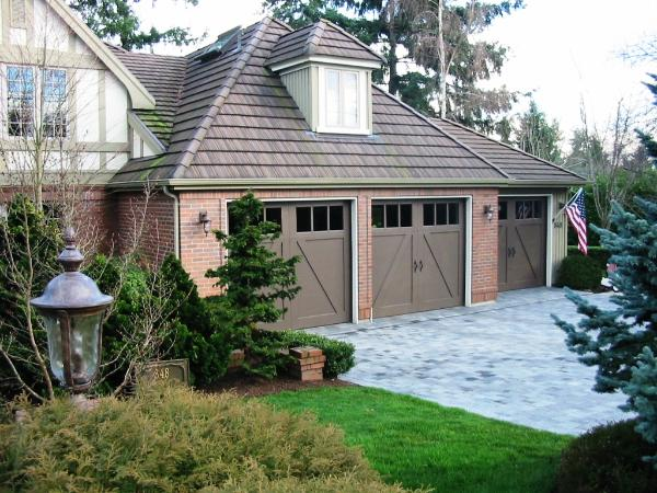 Custom Garage Doors have transformed this beautiful home with carriage house garage doors. Other opening styles for Custom Garage Doors or Carriage Doors include: Out-Swing, In Swing, Hinged, Swinging, Slide, or Fold. The choice is yours for a carriage house door, custom garage doors, or real carriage doors!