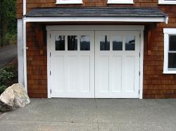 Seattle Garage Doors installed in a carriage door garage.  Choose the opening style that meets your garage door requirements:  Roll-up in sections, Swing-out, Swing-in, Slide, or Fold for your carriage house doors.