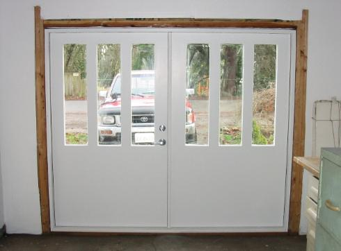 OUTSIDE styling is: Flush/Three Lite.  INSIDE styling is: Flush Back. Many other outside and inside styling  choices are available including:  Flat  Panel, Raised Panel, Square  Edges, and Profiled Edges for both insulated and uninsulated real carriage doors.