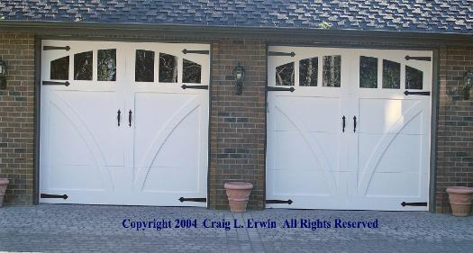 Whidbey Island Waterfront - carriage style garage doors.  Note the perfect custom alignment with the wall lanterns.